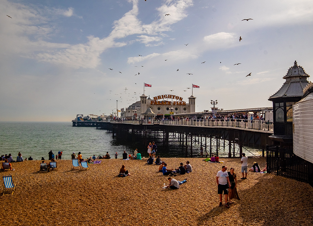 people enjoying good weather on Brighton beach